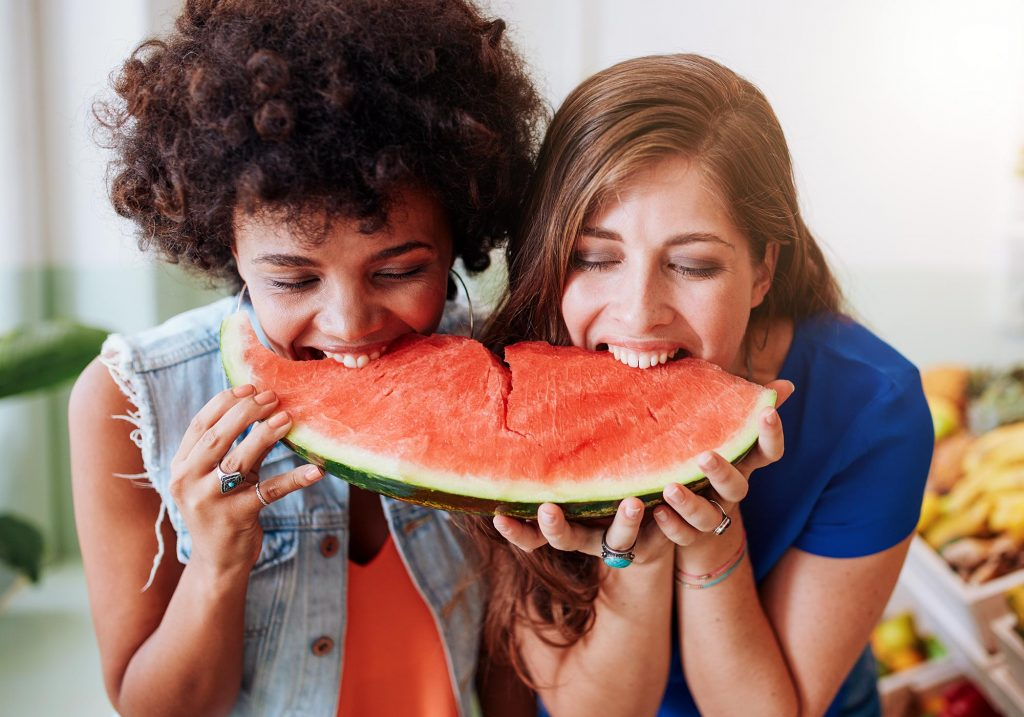 women eating watermelon